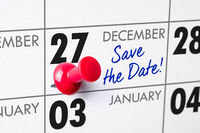 Wall calendar with a red pin - December 27