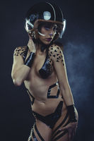 woman with motorcycle helmet, naked girl dressed with black ribbons by the body. concept speed and security