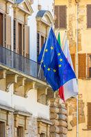 EU and the Italian flag on a balcony