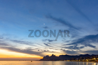 Ipanema beach at dusk with moon