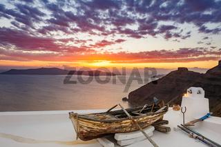 Old wooden boat on roof in Firostefani, Santorini island, Greece