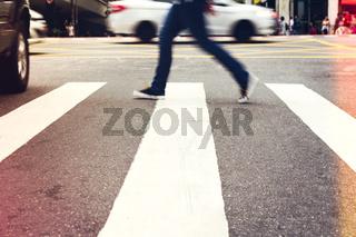 Male is crossing the street.