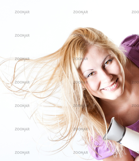 Portrait of a girl with a hairdryer
