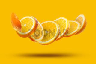 flying orange slices isolated
