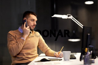 businessman calling on sartphone at night office