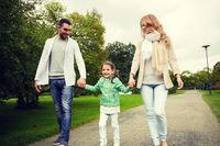 happy family walking in summer park