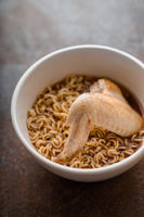 Soup Ramen noodle with chicken wing in ceramic bowl