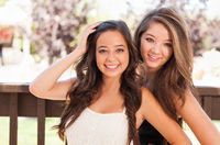Two Mixed Race Girlfriends Pose for Portrait Outdoors