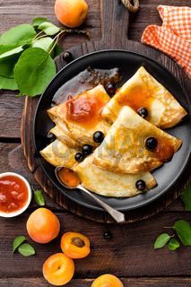 Pancakes with fresh blackcurrant and apricot jam