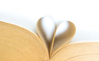 Book with opened pages of shape of heart isolated on white background. Love read concept. Knowledge symbol. Book day