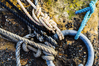 Ropes attached to ring in a harbour