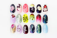 many plastic pink tips for nail extension and training in applying design while training a manicure. trial student work in the form of monograms, flowers and animals, with pasted pastes.