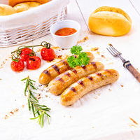 delicious bratwurst with ketchup and fresh rolls