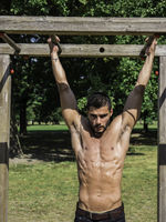 Man exercising and working out in outdoor gym