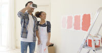 Couple uses virtual reality glasses to choose
