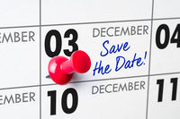 Wall calendar with a red pin - December 03