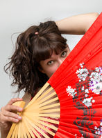 young woman with red fan