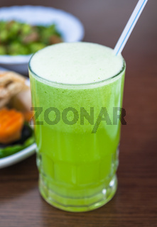 glass with fresh lemon and mint juice