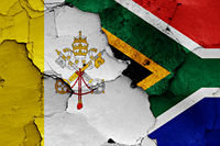 flag of Vatican and South Africa painted on cracked wall