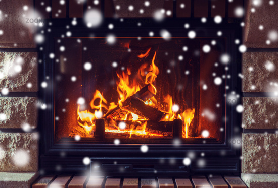 close up of burning fireplace with snow