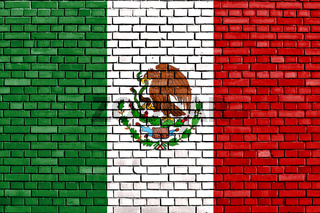 flag of Mexico painted on brick wall