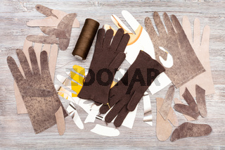 various objects for gloves production on table