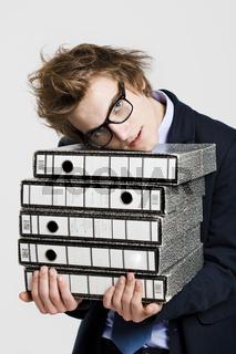 Business man carrying folders