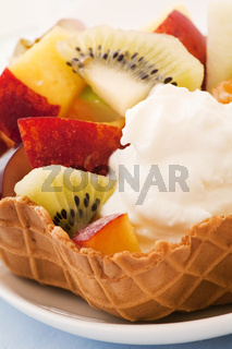 Ice cream with fruit salad as closeup in a wafel