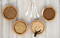 Whole Grains Superfoods Portioned in Ramekins on Wood table