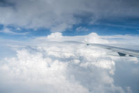 airplane wing above the clouds