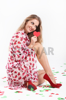 Blond girl with valentine card