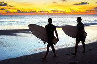 Surfing with friends. Bali island