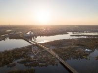 The bridge over the Dnieper River and a panoramic view of the city of Kiev at sunset.