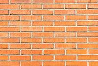 Hintergrund aus einer orangen Backsteinwand