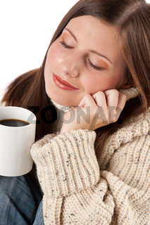 Winter portrait of happy woman holding cup of coffee