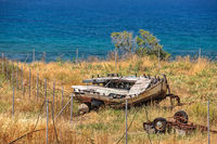 Old broken boat on seashore