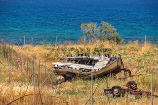 Old broken boat on seashore