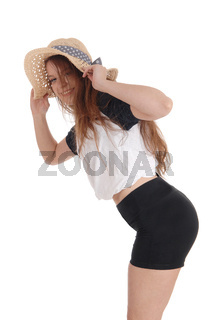 Beautiful woman with a hat and black shorts