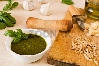 Closeup of pesto genovese with its ingredients