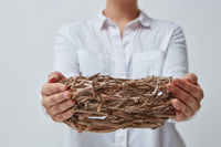 Girl gives an empty nest of branches