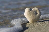 white stone heart on the beach