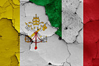 flag of Vatican and Italy painted on cracked wall