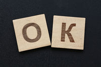 Word OK on wooden signs over black