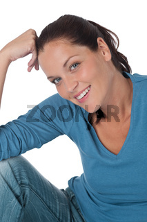 Happy young woman looking at camera