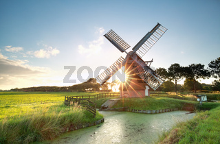 sunshine behind Dutch windmill