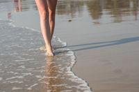 Woman walking on a beach