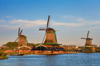 Windmills at Zaanse Schans in Holland in twilight on sunset. Zaa