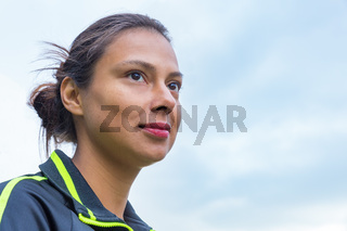 Portrait head of colombian woman with sky