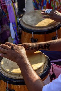 Drum player hands and instrument at samba performace
