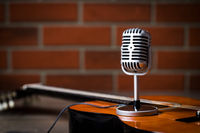 Vintage microphone and guitar.
